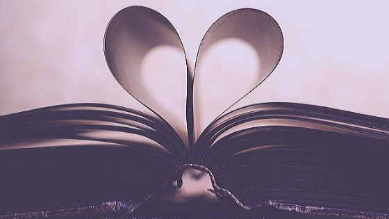 open book with pages bent into a heart