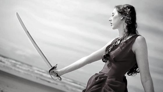 Lynette with sword on beach