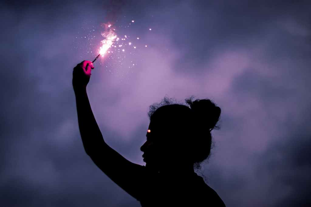 Image: silhouette of young girl holding a sparkler